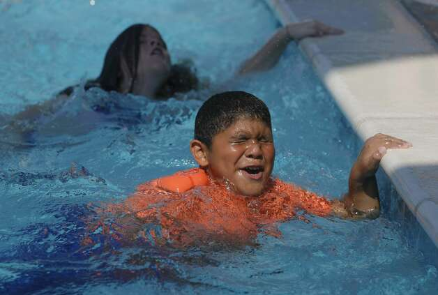 Josue Lopez comes up for air as more than 100 youth from around Montgomery County take part in this year's World's Largest Swimming Lesson at the City of Conroe Water Park, Friday, June 18, 2021, in Conroe. The WLSL event occurs once a year where participating groups take part in the same swim lesson across 48 countries. Since beginning in 2010, the event has reached 320,000 people and serves as a platform to help the global aquatics industry work together to build awareness about the fundamental importance of teaching children to swim to prevent drowning. Photo: Jason Fochtman/Staff Photographer / 2021 © Houston Chronicle