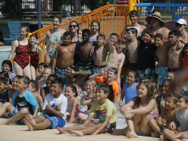 More than 100 youth from around Montgomery County took part in this year's World's Largest Swimming Lesson at the City of Conroe Water Park, Friday, June 18, 2021, in Conroe. The WLSL event occurs once a year where participating groups take part in the same swim lesson across 48 countries. Since beginning in 2010, the event has reached 320,000 people and serves as a platform to help the global aquatics industry work together to build awareness about the fundamental importance of teaching children to swim to prevent drowning. Photo: Jason Fochtman/Staff Photographer / 2021 © Houston Chronicle