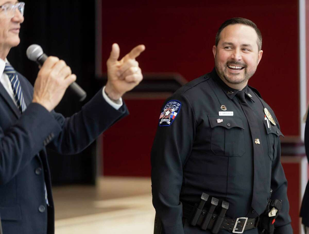 David Branson, from the Montgomery ISD police department, right, shares a laugh as he's introduced by Randy Kirkman during a graduation ceremony from training with the D.A.R.E. program at Stockton Junior High School, Friday, June 18, 2021, in Conroe. The program lasted approximately two weeks.