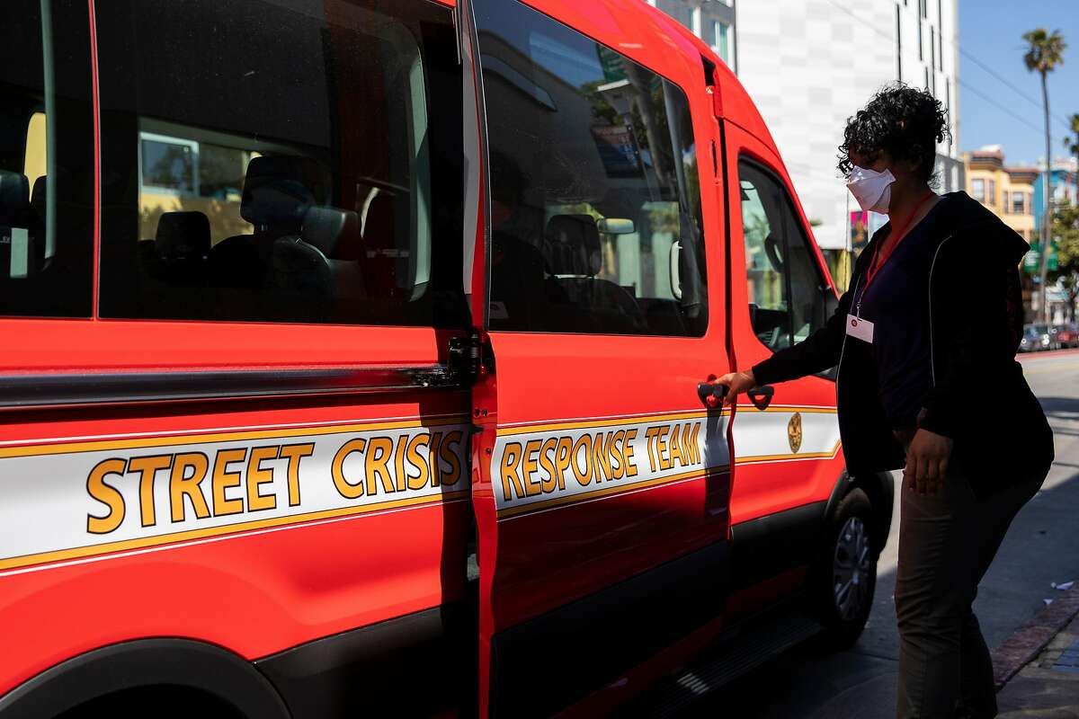 Crisis Response Team member and peer specialist Vania Mendoza loads into the crisis response team van in with her peers after successfully transporting a homeless man in distress to the hospital in San Francisco, Calif. Tuesday, May 11, 2021.