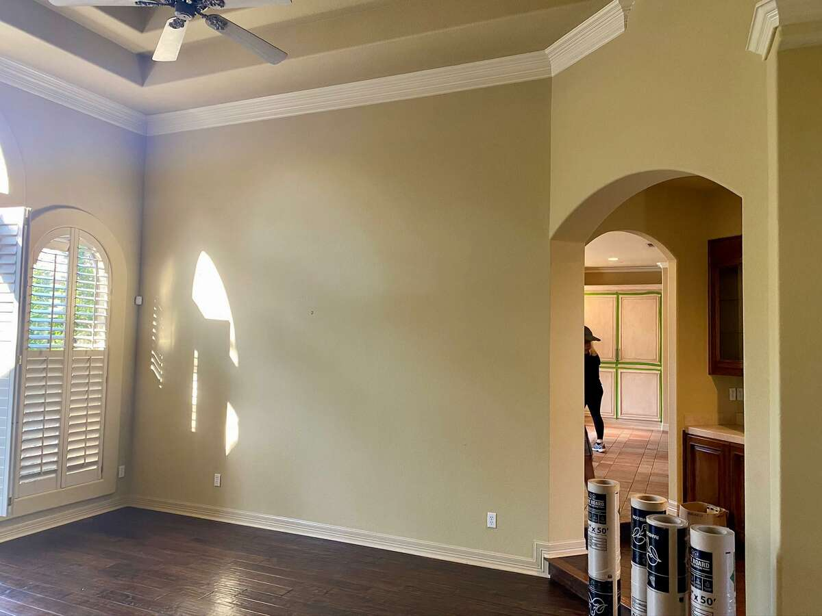 The dining area originally had tray ceilings, a very 1990s look that the home's owners wanted to update.