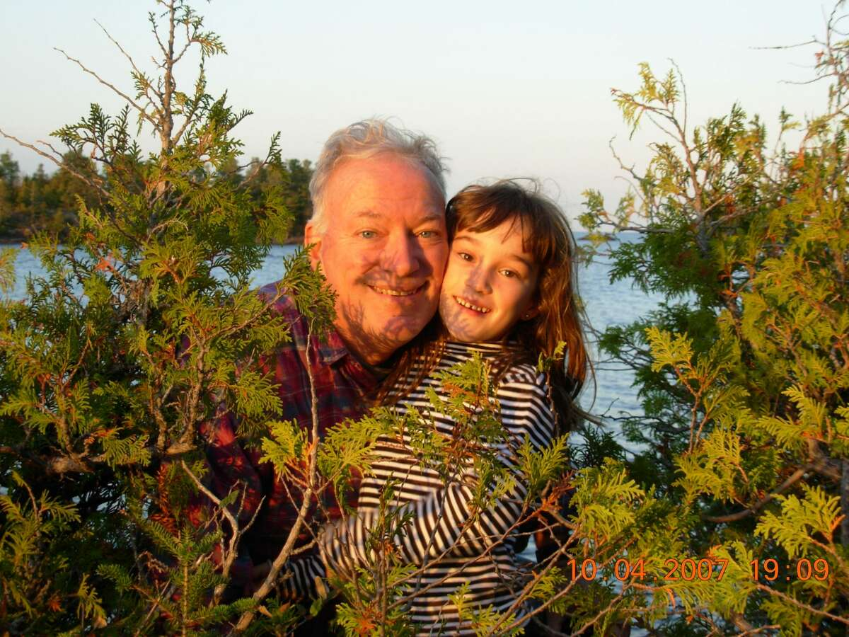 Dennis Abraham, left, and his daughter, Aurora Abraham, right, pose for a photo Oct. 4, 2007 in the Upper Peninsula.