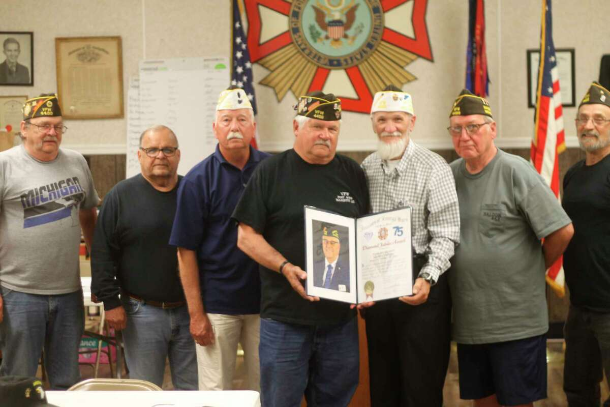 Pictured (from left to right) are Robert Cromwell, Wally Grant, Stanley Preidis,VFW Walsh Post No. 4499 commander Don Vadeboncoeur, VFW Department of Michigan representative Rick Schafer, Ed Cote and Al Hamlett. Schafer visited the post Thursday with a certificate to commemorate the post's 75th anniversary. (Kyle Kotecki/News Advocate)
