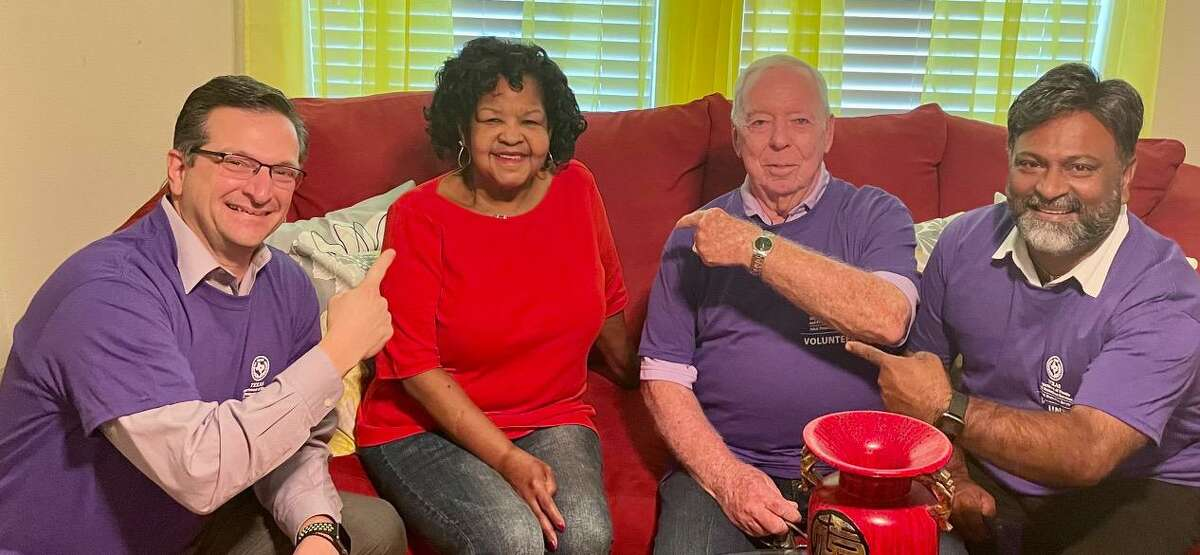 Councilman Floyd Emery, Mayor Robin Elackatt and Councilman Anthony Maroulis at the home of Joyce Ford. Ford resides at the Huntington, a mature adult apartment home community in Missouri City's Sienna Plantation.