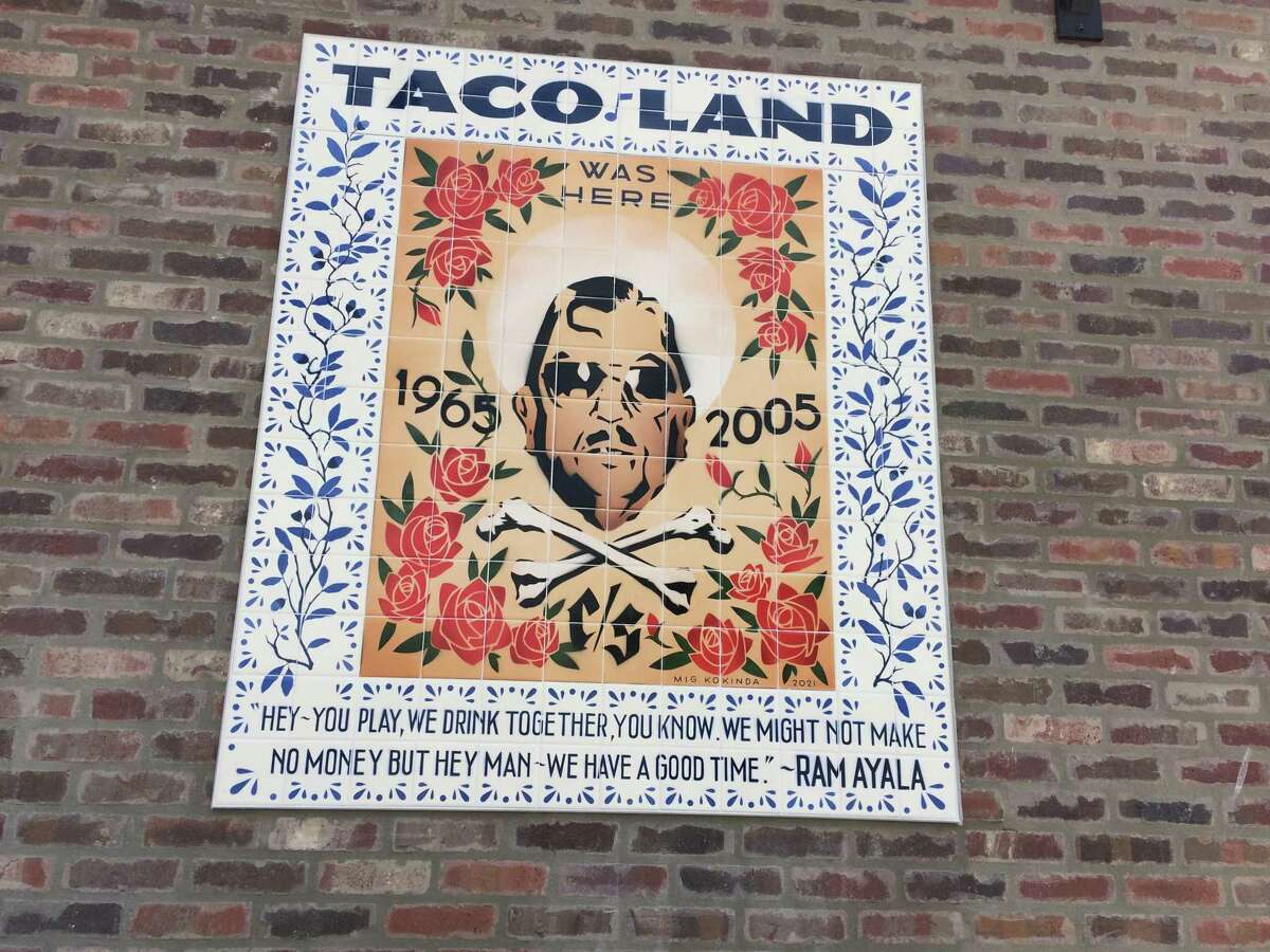 """A tile mural paying tribute to the late Ramiro """"Ram"""" Ayala and Taco Land, the legendary punk rock club he ran until he was killed during a robbery there, has been installed at Velvet Taco. The restaurant is on the site of Taco Land."""