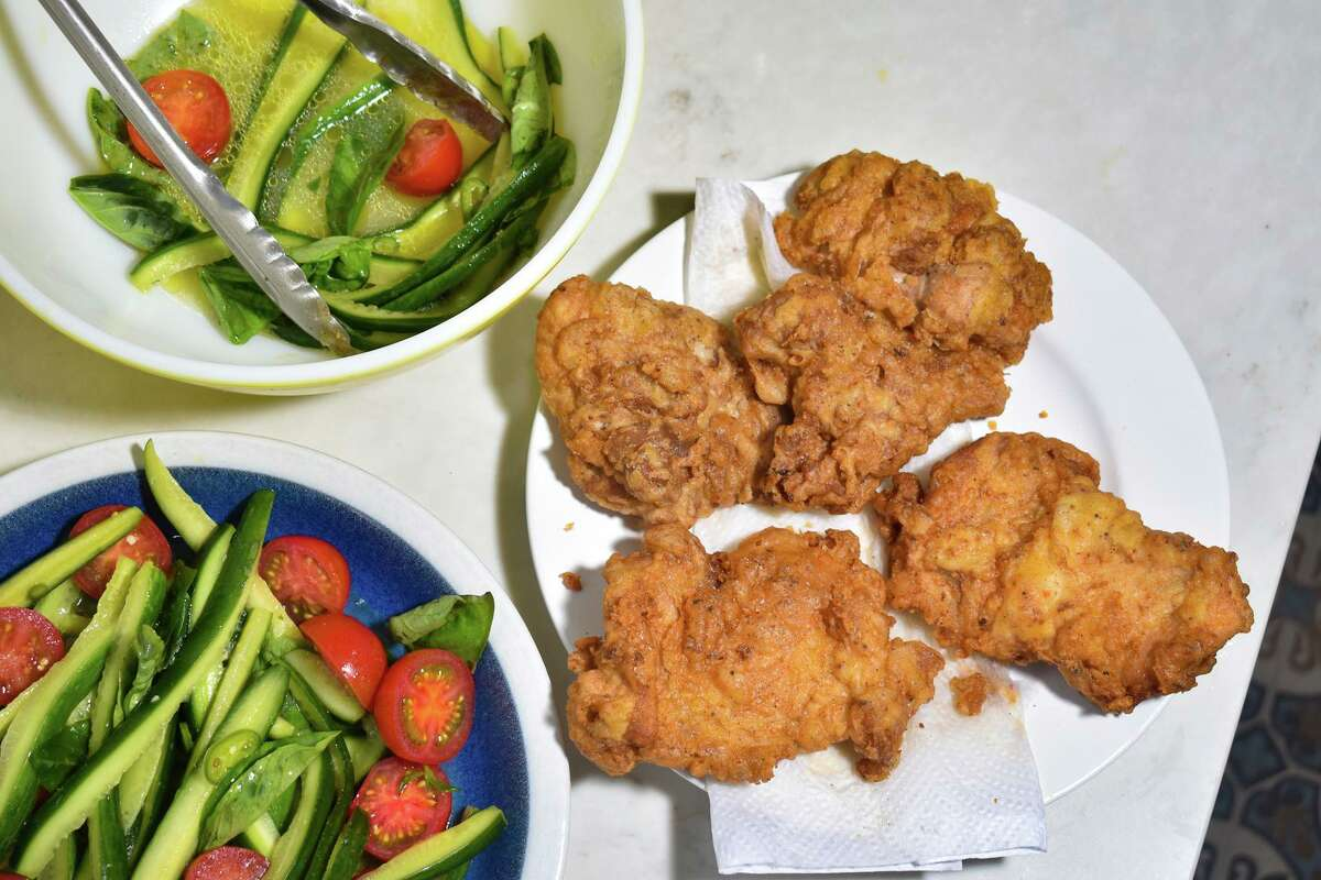 The garlicky fried chicken is the star, of course, but the crunchy cucumber salad is a umami-packed accompaniment.
