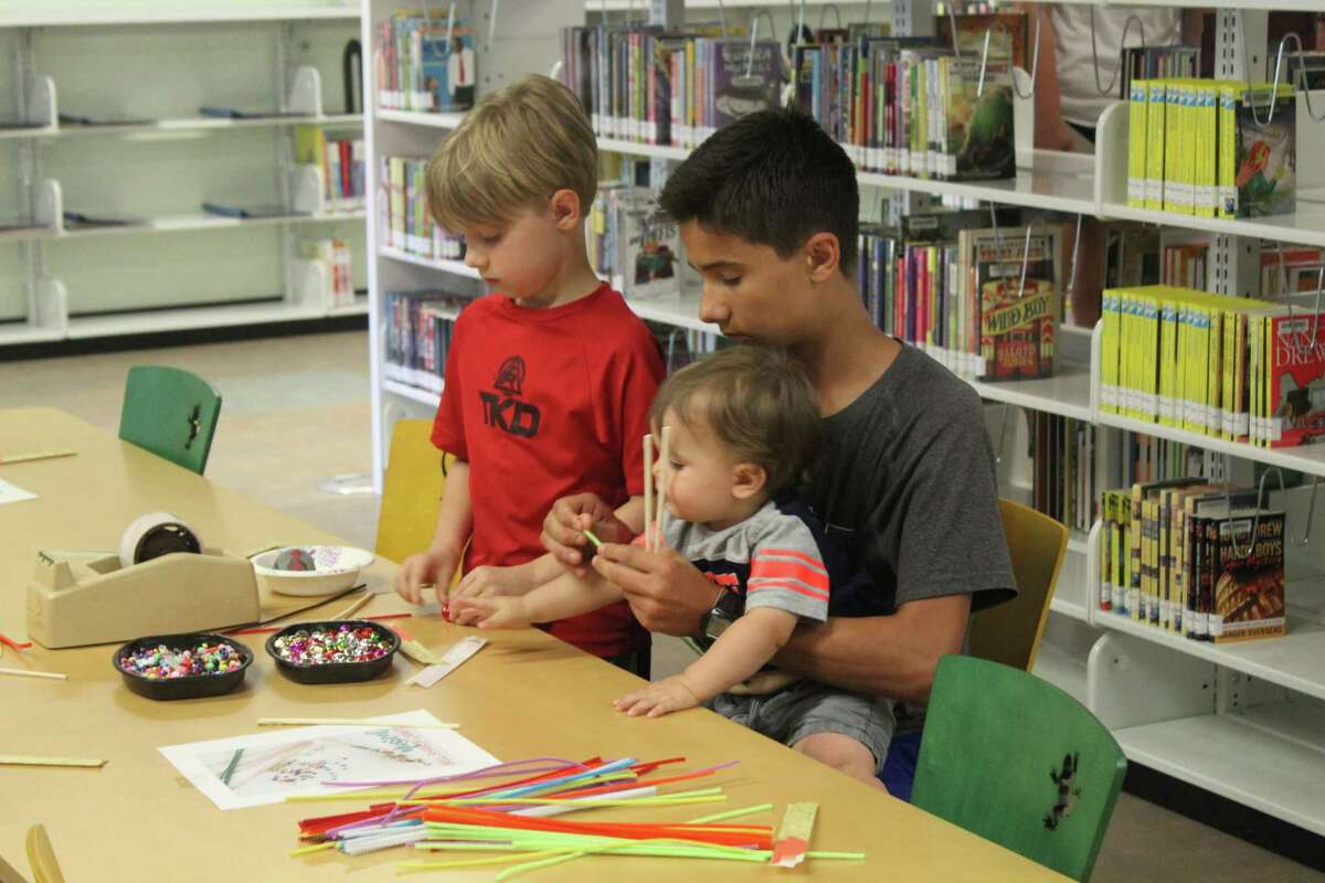 Kids participate in arts and crafts during the HCPL Kingwood Branch Library's grand reopening celebration in June 2918.