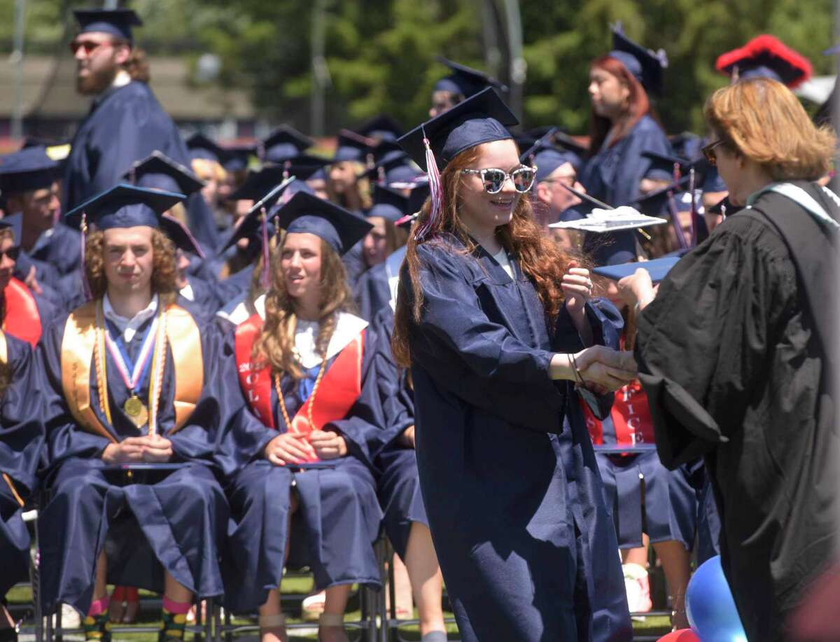Sara Azzi receives her diploma during the New Fairfield High School Class of 2021 Commencement Exercises. Friday morning, June 18, 2021, in New Fairfield, Conn.