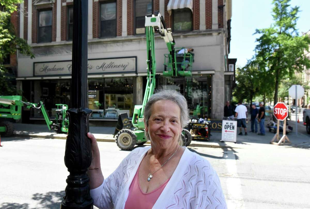 Kathy Sheehan, historian for the city of Troy and for Rensselaer County based at the Hart Cluett Museum, stands on Broadway at Monument Square where movie crews for 'The Gilded Age' remove what's left of the massive period set on Friday, June 18, 2021, in Troy, N.Y. (Will Waldron/Times Union)
