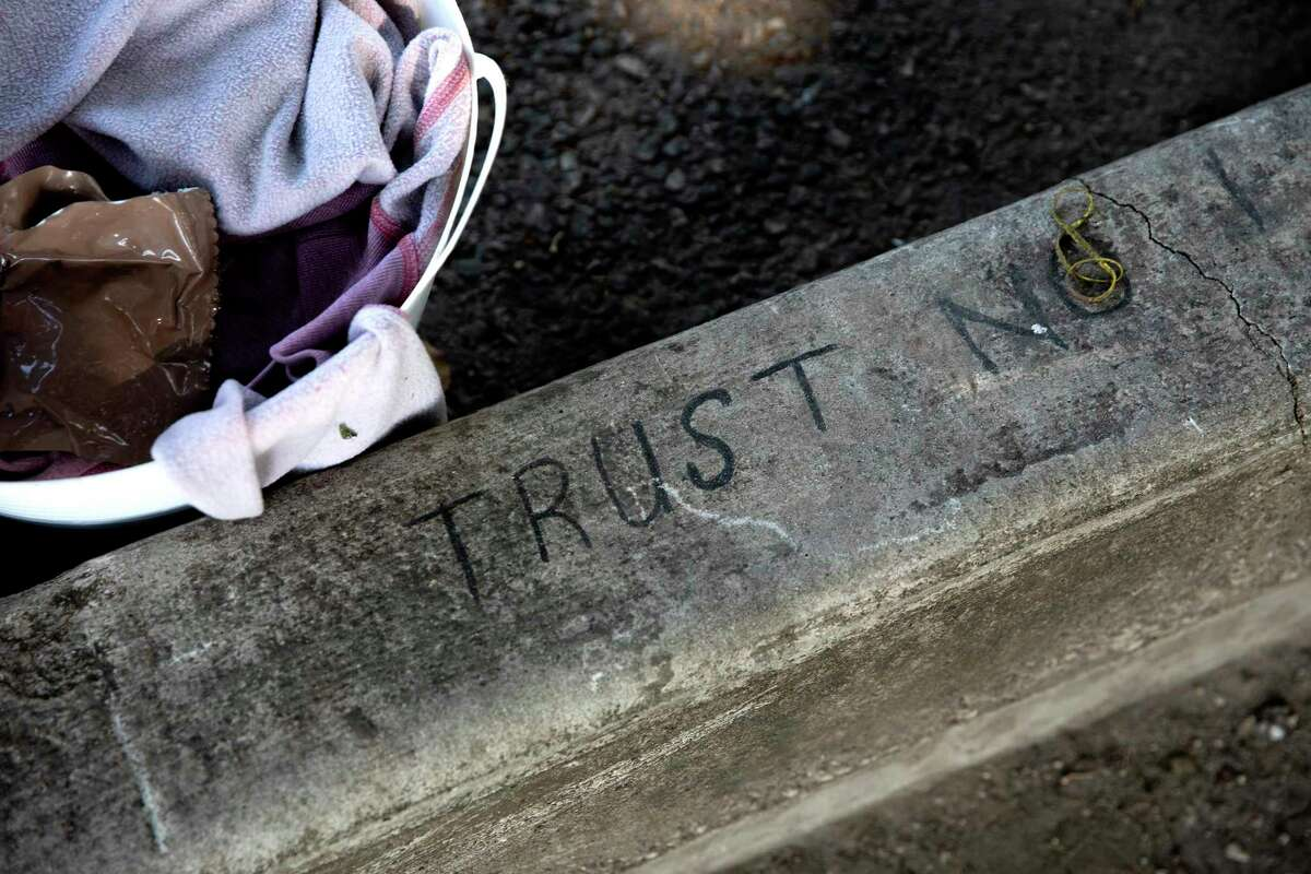 The words 'Trust No' are written at the edge of the District 1 Field Office where former city councilman Robert Trevino had let unsheltered people camp.