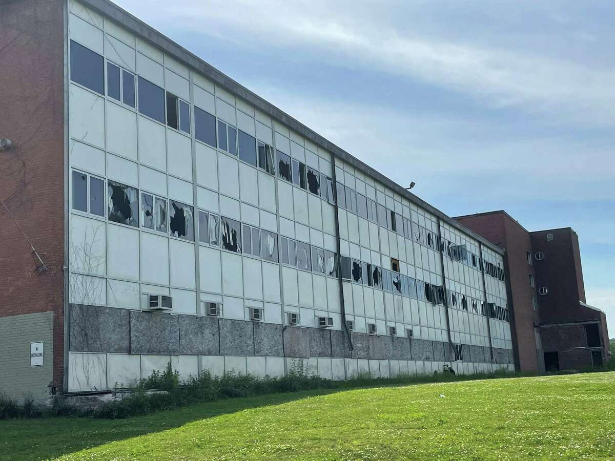 Broken windows line the side of the abandoned middle school at 560 Newhall St. in Hamden June 18, 2021