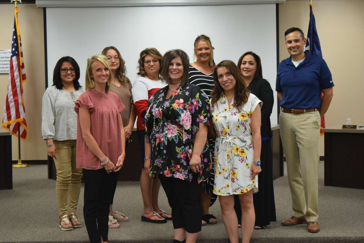 """The Plainview ISD School Board recognized a new hire and a couple of individuals who will serve the district in different capacities for the 2021-2022 school year on Thursday night. (Pictured front from left) Amanda Aycock will join the district as an assistant principal in the fall. (middle) Megan Biggs will also join the district as an assistant principal. Just before the district's newest assistant principals were presented to the board, Paulina Gonzales (right) was recognized as the newest member of the language acquisition team. While she's new to that team, Gonzales is not new to the district. She was described Thursday night as a """"phenomenal teacher"""" who has been nominated at least twice for teacher of the year accolades.Behind them from left: Board members JoAnn Rey, Sofia Rivera, Sylvia De La Garza, Amber Bass and Superintendent H.T. Sanchez"""