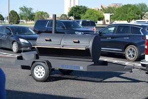 """A while back, the late Robert Rivera asked his friend, H.T. Sanchez to build him a grill. Sanchez, superintendent of Plainview ISD, likes to weld. It's a hobby he enjoys when taking a break from running the district. Rivera, an officer for Plainview ISD, approached Sanchez with a design and Sanchez happily agreed. He started the project but didn't finish it before Rivera's untimely death from COVID-19 in December. Sanchez continued the project consulting with friends who are welders and with local artist Rigo Rey (who helped create a logo design for the grill) and finished the project in memory of their friend. On Thursday, Sanchez presented the grill – which has blue letters in the corner that say """"The Blue Line Express"""" – to Rivera's wife, Sofia. Sofia shed some surprised tears and thanked Sanchez joking that she and her daughters would have to learn how to grill."""
