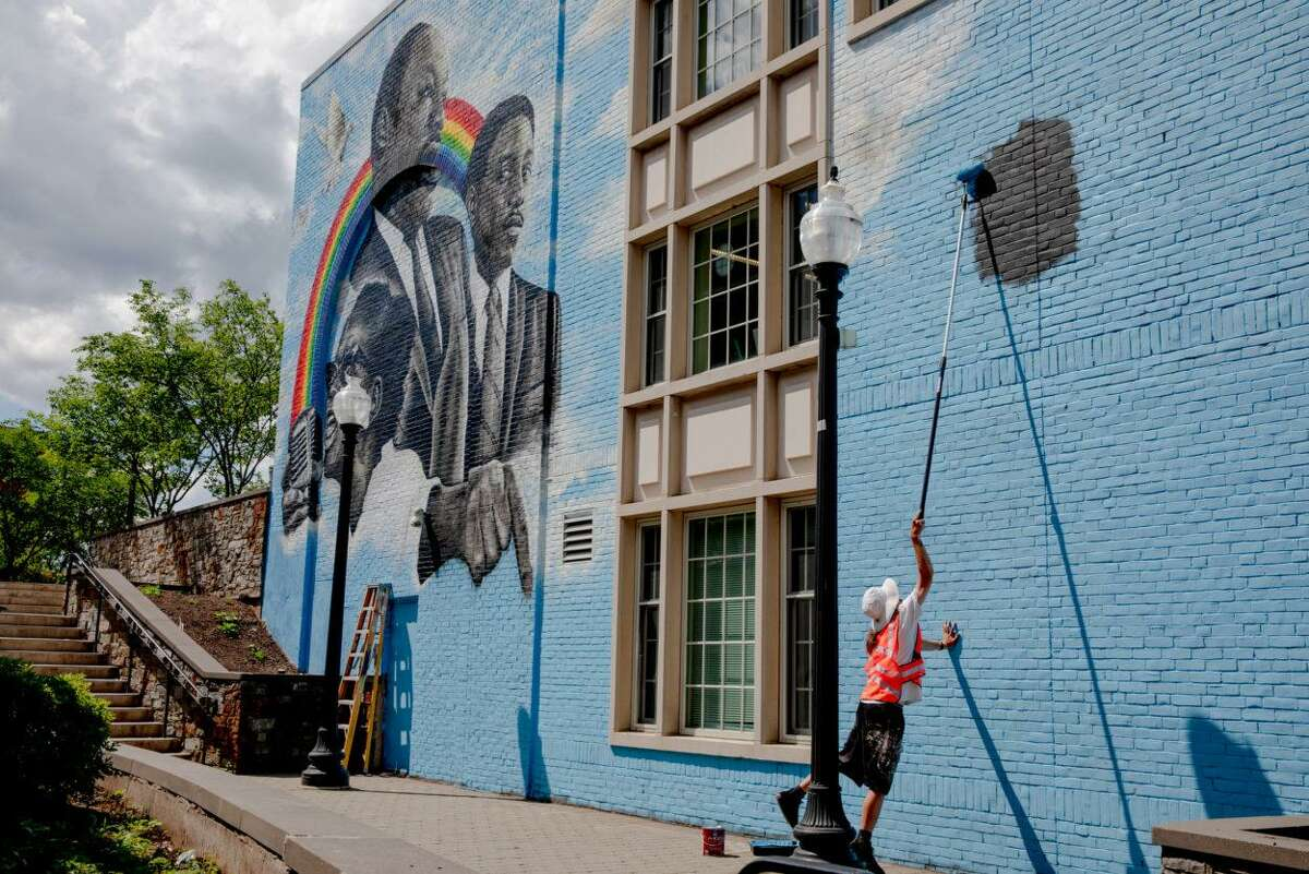 Corey Pane, an artist in West Hartford, painted Ella Baker, Martin Luther King Jr. and Dr. Bernard LaFayette on the wall of Noah Webster Library in West Hartford.