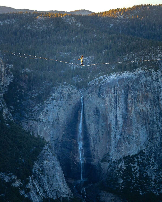 Highliner Moises Monterrubio walking the 2,800-foot-long line at Taft Point above Yosemite Valley.
