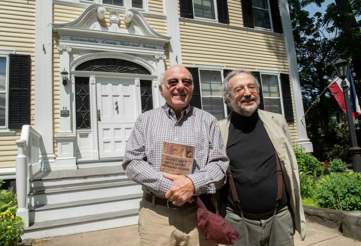Brothers James and Martin Strosberg stand outside the Schenectady Historical Society on Thursday, June 17, 2021 in Schenectady, N.Y. The two doctors wrote a book on infectious diseases in Schenectady. (Lori Van Buren/Times Union)