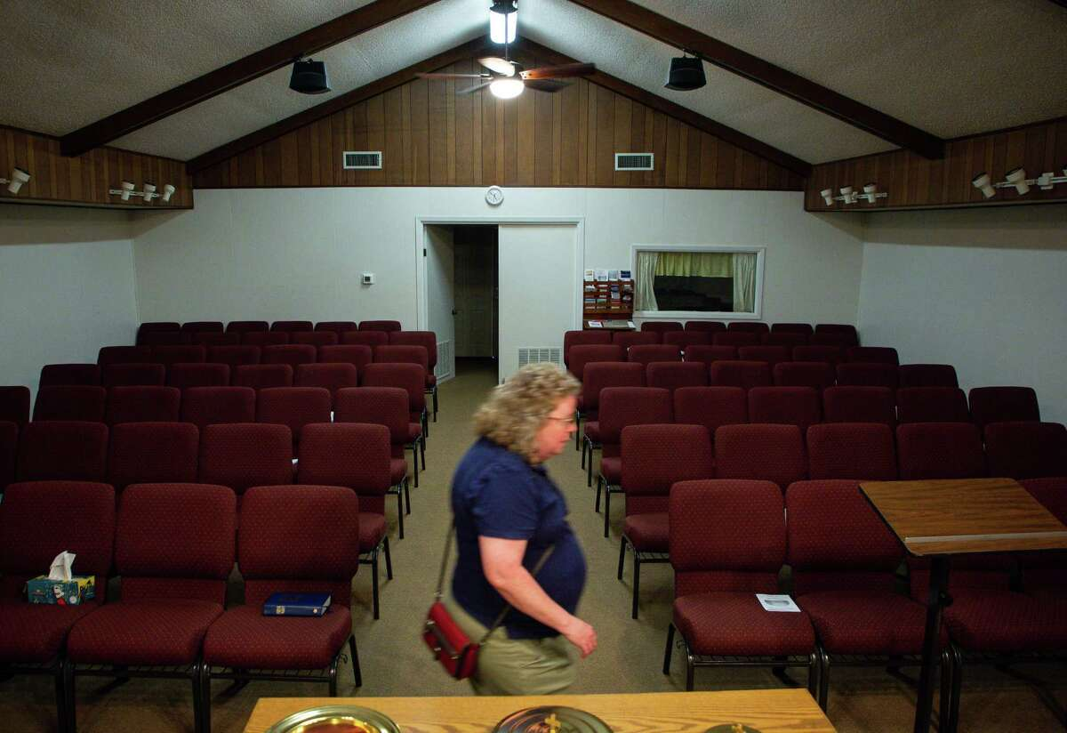 Church of Christ member Tammy Sanford walks through the sanctuary on Wednesday, June 16, 2021, in Iola. The city received money from the $1 billion in federal Hurricane Harvey money that the state of Texas distributed to local governments in May for a waste water treatment facility. Iola's worst and most recent flood happened in 2016.
