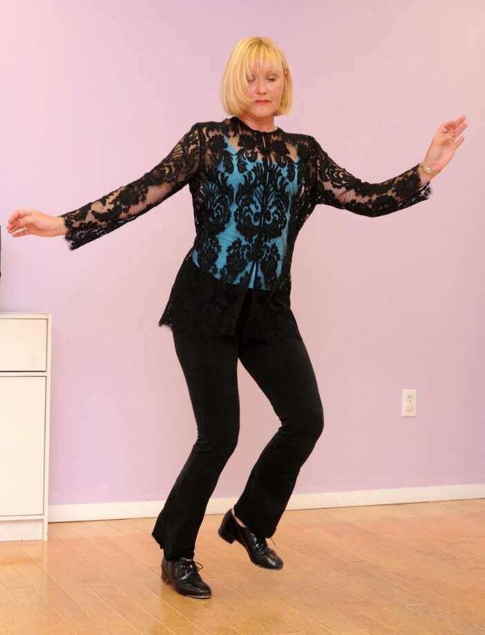 Jeri Kansas, the new tap dance instructor at Just Dance School of Performing Arts in Danbury, CT demonstrate a tap dancing routine on Wednesday, Sept. 2, 2009. Photo: Jay Weir / The News-Times