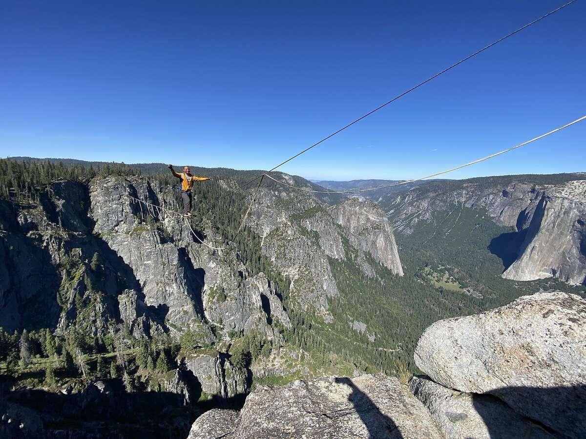 Highliner Jimmy Breiz balances on the 2,800-foot-long line at Taft Point above Yosemite Valley.