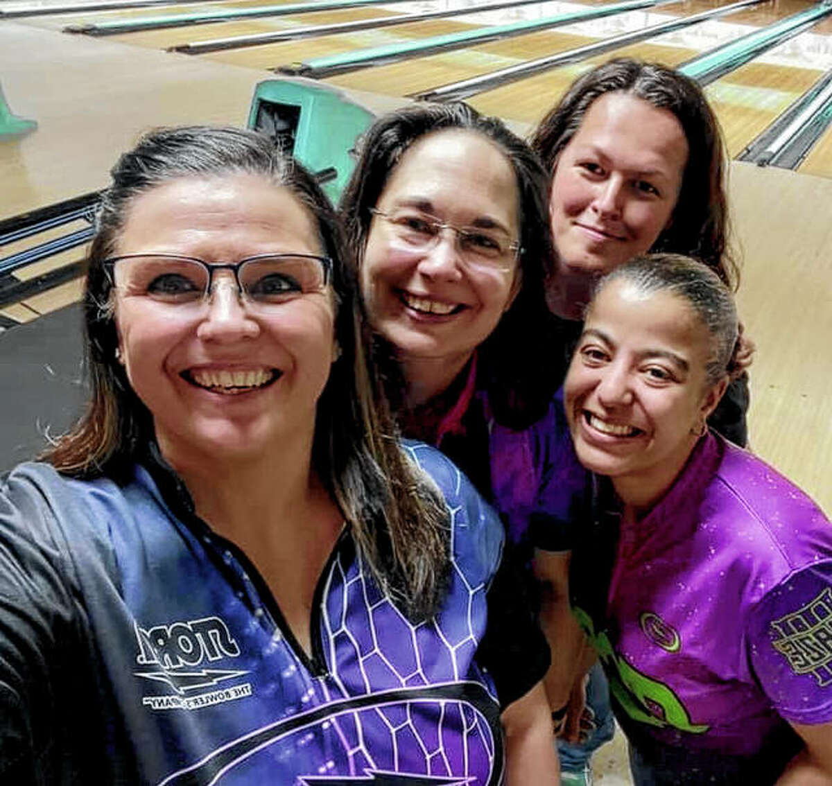 (From left) Tammy Welsh, Lisa Timm, Kala Grigg and Michelle Riley bowled a scratch score of 2,835 to win the scratch division of the Central Illinois Tournament last week.