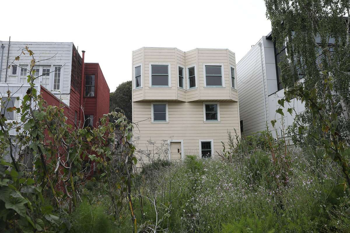 """The small house 4250 26th St. in Noe Valley featured a """"secret garden,"""" where the former owner grew Swiss chard, asparagus and strawberries and let kids play and pick as much produce as they wanted."""