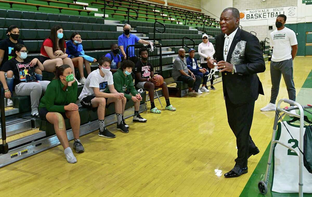Basketball Hall of Famer and Norwalk High School alumni Calvin Murphy addresses alumni, fans and students, as he returns to the school for first time in several years for program on Friday in Norwalk.