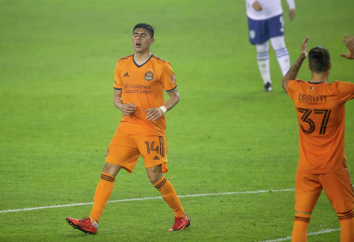 Houston Dynamo FC midfielder Joe Corona (14) reacts after a missed shot on goal against the San Jose Earthquakes during the second half of an MLS match at BBVA Stadium on Friday, April 16, 2021, in Houston. The Dynamo won 2-1.