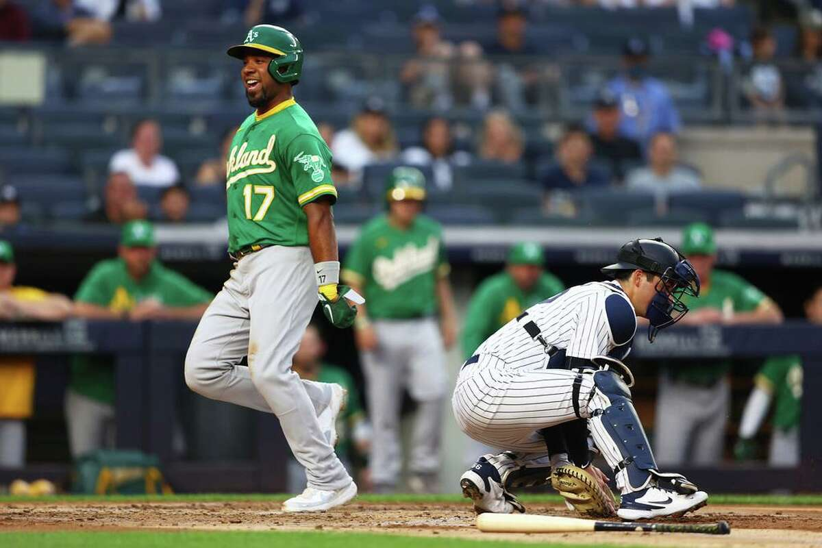 NEW YORK, NEW YORK - JUNE 18: Elvis Andrus #17 of the Oakland Athletics scores on Mark Canha #20 RBI single in the third inning against the New York Yankees at Yankee Stadium on June 18, 2021 in New York City. (Photo by Mike Stobe/Getty Images)
