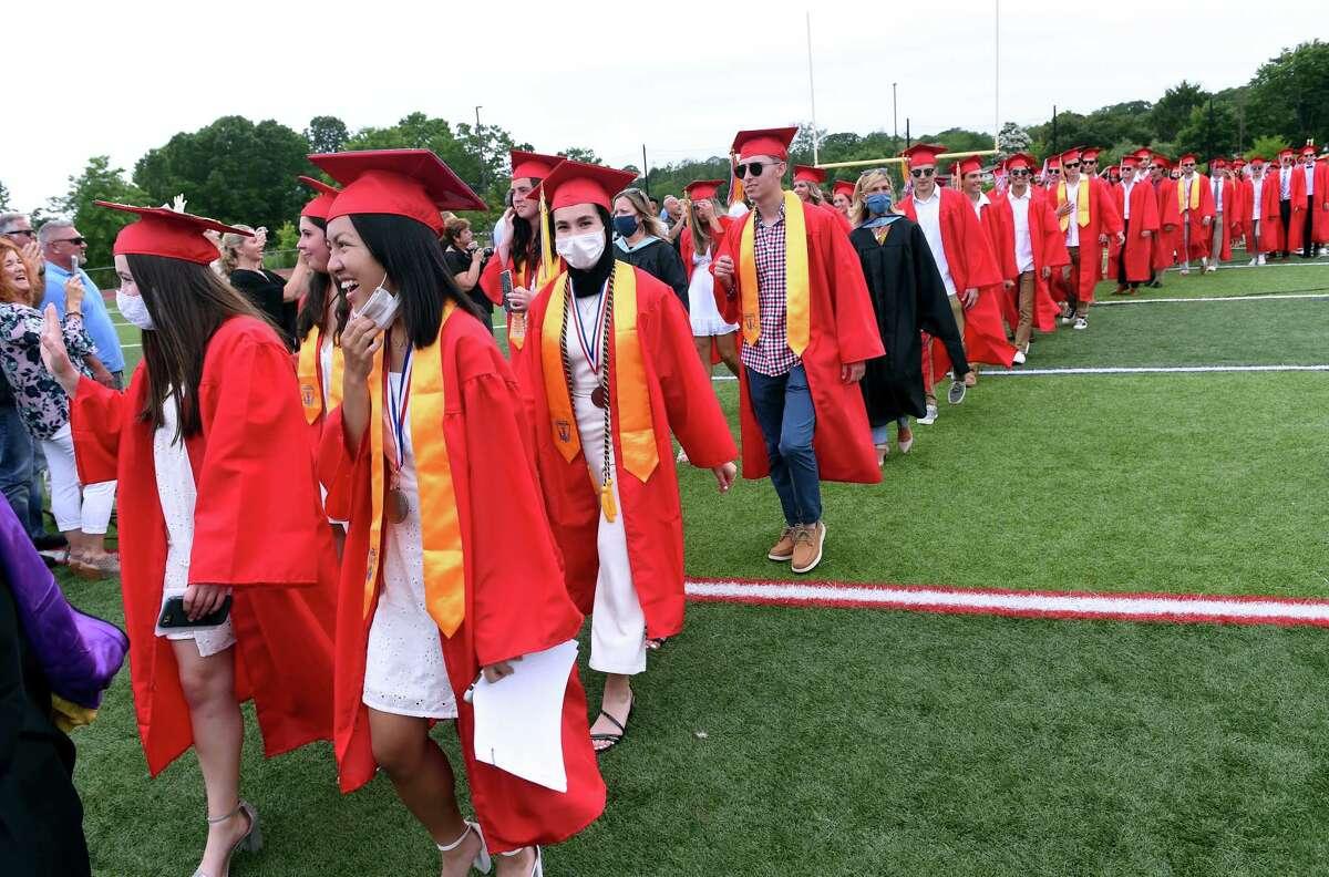 Graduates march into graduation ceremonies at Branford High School's James L MacVeigh Alumni Athletic Complex on June 18, 2021.