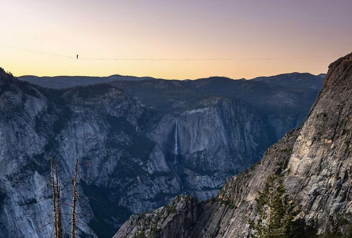 Highliner Daniel Monterrubio walks the 2,800-foot-long line off Taft Point above Yosemite Valley.