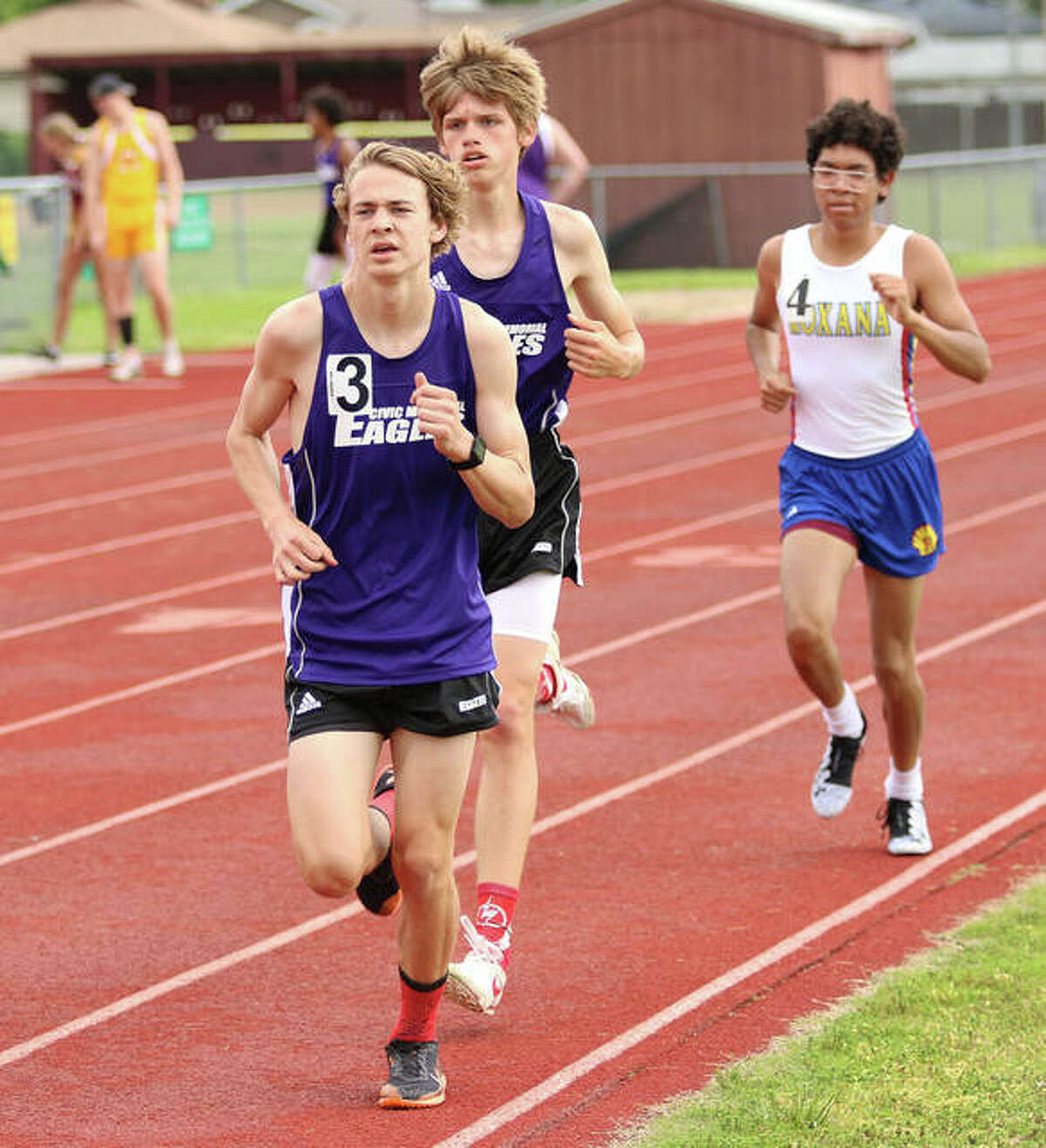 CM's Jackson Collman (left) finished 13th overall in the 3,200-meter run at Friday's IHSA Class 2A Boys State Track Meet in Charleston. He is shown running the 3,200 at the Madison County Meet May 17 in Wood River.