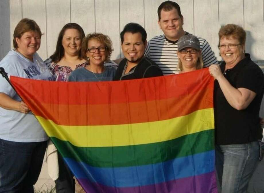 Staff at the Ranch Hill Saloon in Spring pose with the Pride flag. Photo: Debbie Steele