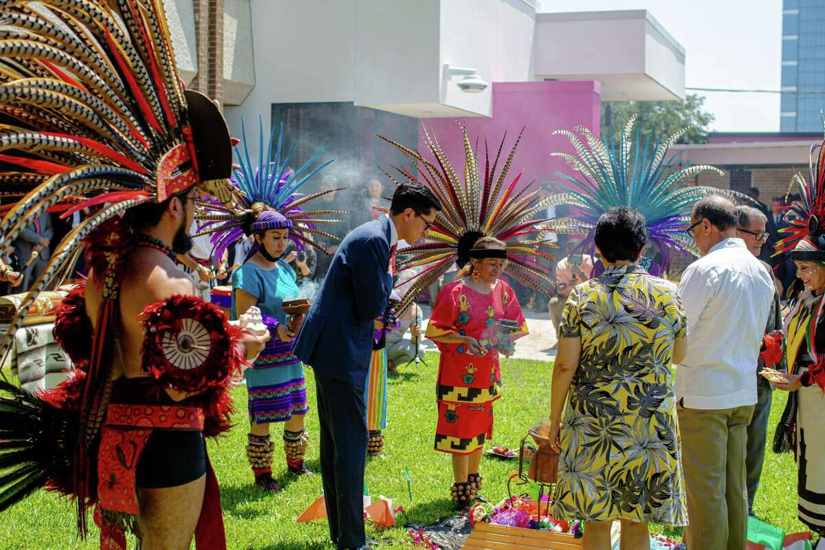 Roberto Velasco Alvarez, chief officer for North America at the Ministry of Foreign Affairs, lights the fire as Chikawa dancers perform to celebrate the new Mexican Consulate building during ceremony in Houston, Friday, June 18, 2021.