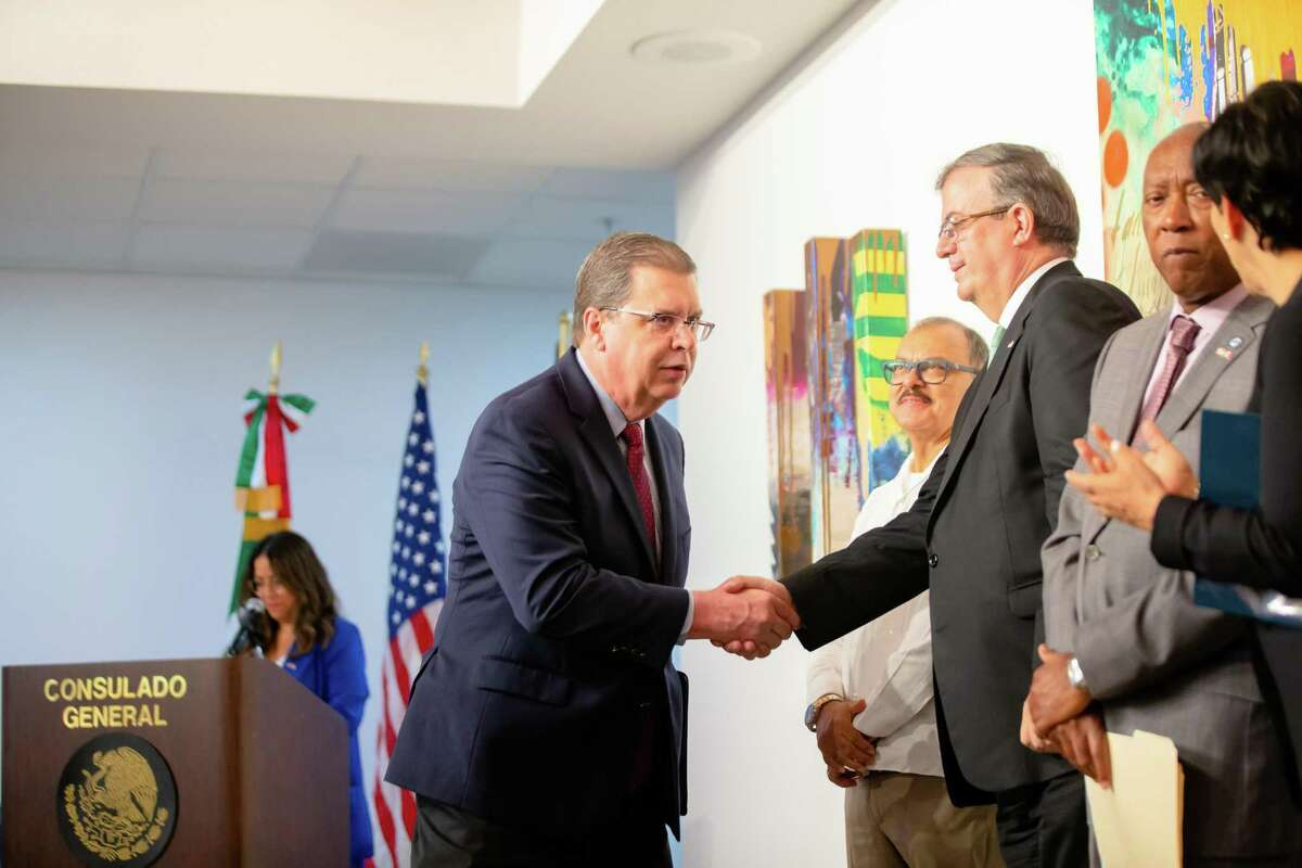 Mexico's Minister of Foreign Affairs Marcelo Ebrard Casaubón, center, shakes hands with Quincy Allen, Director of District Operations for the Texas Department of Transportation, during a ceremony at the Mexican Consulate, Friday, June 18, 2021, in Houston.