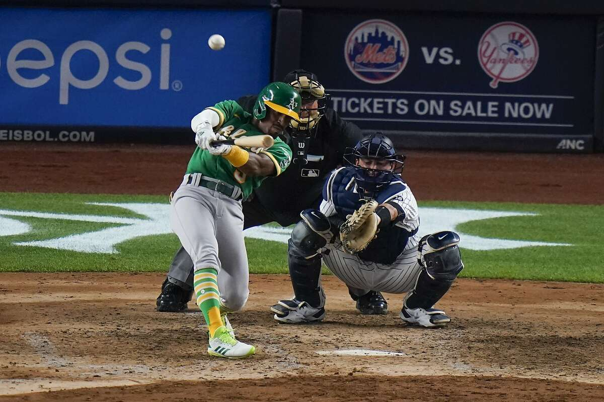 Oakland Athletics' Tony Kemp hits a three-run home run during the sixth inning of the team's baseball game against the New York Yankees.