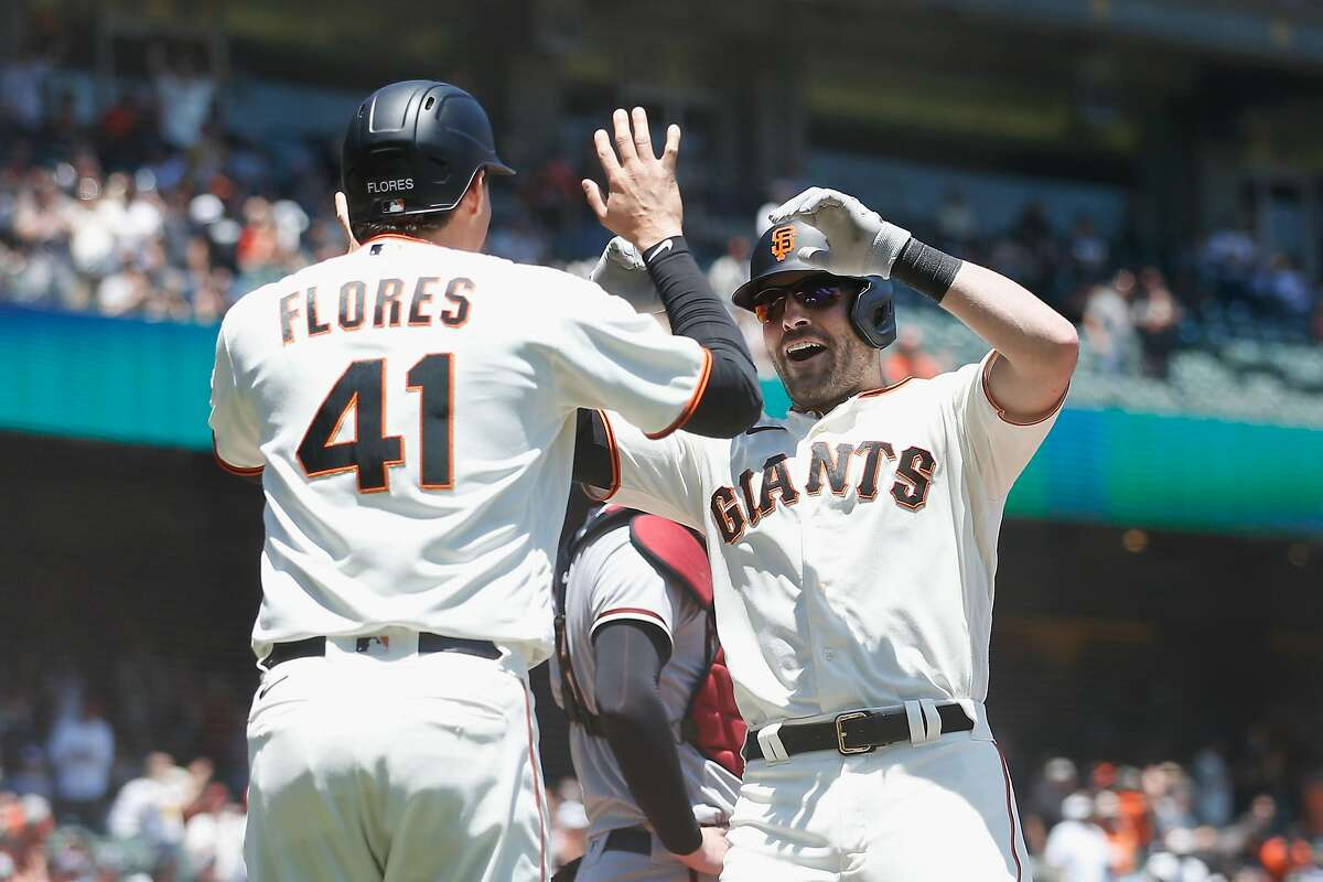 SAN FRANCISCO, CALIFORNIA - JUNE 17: Curt Casali #2 of the San Francisco Giants celebrates with Wilmer Flores #41 after hitting a two-run home run in the bottom of the second inning at Oracle Park on June 17, 2021 in San Francisco, California. (Photo by Lachlan Cunningham/Getty Images)