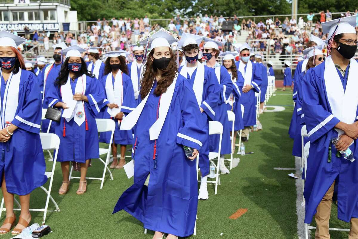 Darice Alvado, 17, at center, stands with her class at the Brien McMahon High School graduation on Friday, June 18, 2021.