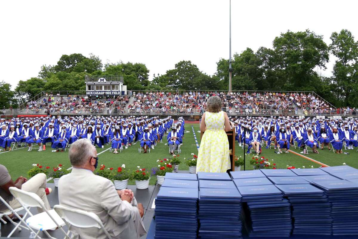 Mayor Harry Rilling, at left, listens as Superintendent of Schools Alexandra Estrella commends the class for having grit at the Brien McMahon High School graduation on Friday, June 18, 2021.