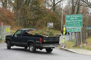 A truck carrying yard waste pulls into the Holly Hill Resource Recovery Station in Greenwich, Conn. Wednesday, Nov. 20, 2019.