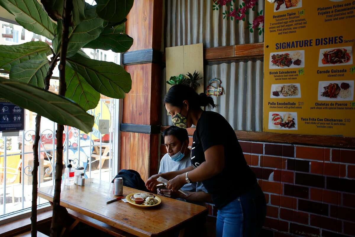 Doris Vargas serves a customer at her family's restaurant, Panchita's, in the Mission in San Francisco. Vargas is the third generation in her family's pupusa business.