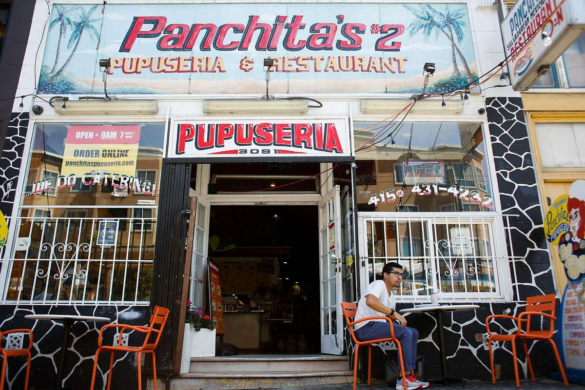 A man eats outside Panchita's restaurant in the Mission.