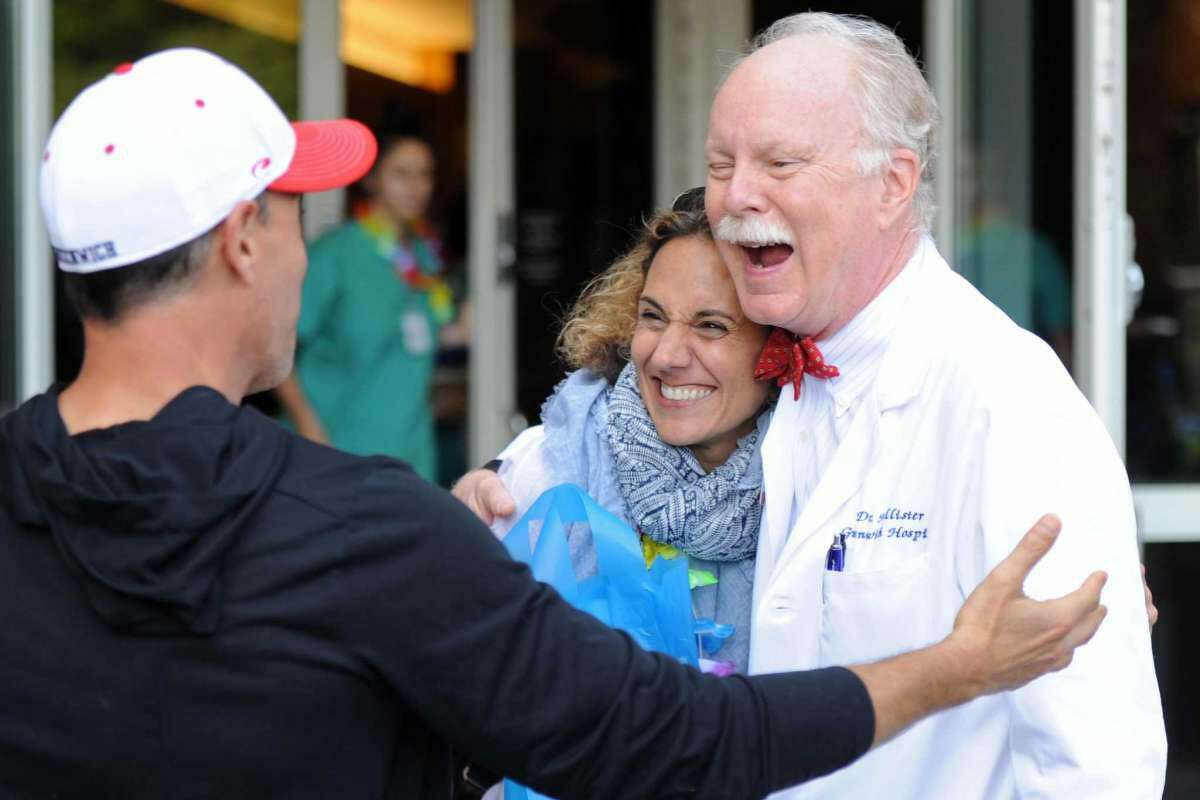 Dr. Dickerman Hollister, right, says hello to his former patients and cancer survivors Frank Carbino and Lisa Gioffre, of Greenwich, at the Cancer Survivors' Celebration at Greenwich Hospital in Greenwich, Conn. Thursday, June 7, 2018.