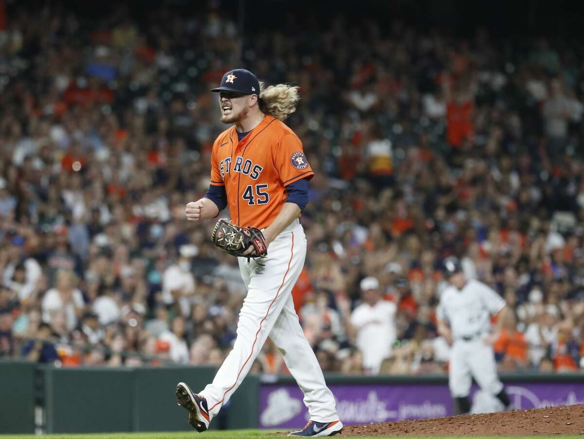 Houston Astros relief pitcher Ryne Stanek (45) reacts after striking out Chicago White Sox Jake Lamb to end the top of the eighth inning of an MLB baseball game at Minute Maid Park, Friday, June 18, 2021.