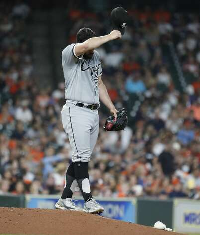 Chicago White Sox starting pitcher Carlos Rodon (55) reacts after giving up the first hit of the night to Houston Astros Yordan Alvarez during the fifth inning of an MLB baseball game at Minute Maid Park, Friday, June 18, 2021. Photo: Karen Warren/Staff Photographer / @2021 Houston Chronicle