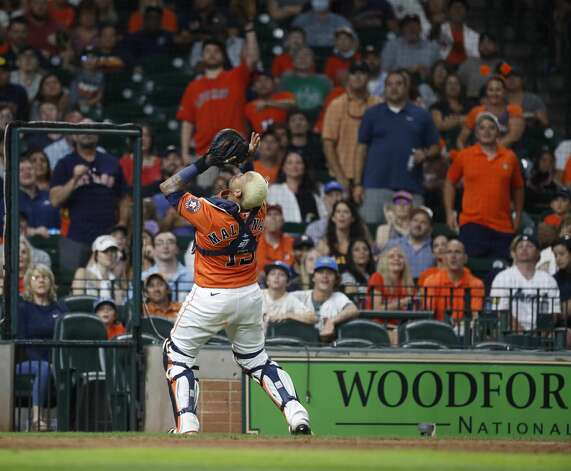 Houston Astros catcher Martin Maldonado (15) catches Chicago White Sox Yasmani Grandal's pop out during the sixth inning of an MLB baseball game at Minute Maid Park, Friday, June 18, 2021. Photo: Karen Warren/Staff Photographer / @2021 Houston Chronicle