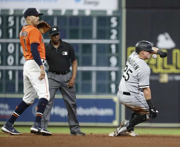 Chicago White Sox Andrew Vaughn (25) gets hit in the face by a throw from Houston Astros right fielder Chas McCormick on Vaughn's double during the sixth inning of an MLB baseball game at Minute Maid Park, Friday, June 18, 2021. Photo: Karen Warren/Staff Photographer / @2021 Houston Chronicle