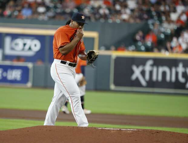 Houston Astros starting pitcher Luis Garcia (77) wipes his face after Chicago White Sox Jose Abreu's RBI single during the first inning of an MLB baseball game at Minute Maid Park, Friday, June 18, 2021. Photo: Karen Warren/Staff Photographer / @2021 Houston Chronicle