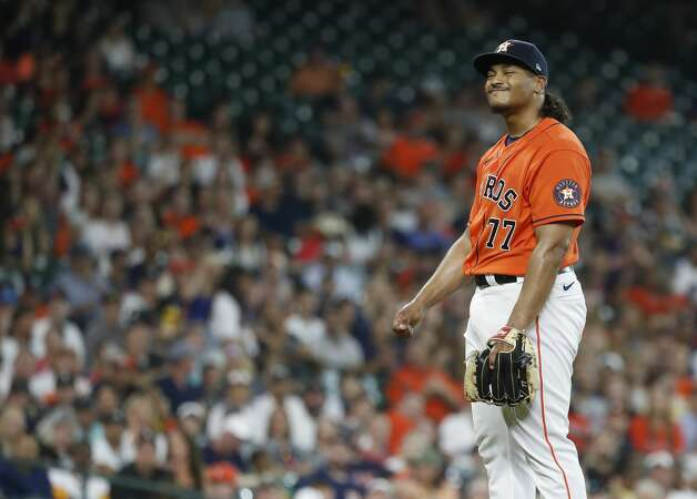 Houston Astros starting pitcher Luis Garcia (77) reacts after walking Chicago White Sox Danny Mendick during the second inning of an MLB baseball game at Minute Maid Park, Friday, June 18, 2021. Photo: Karen Warren/Staff Photographer / @2021 Houston Chronicle