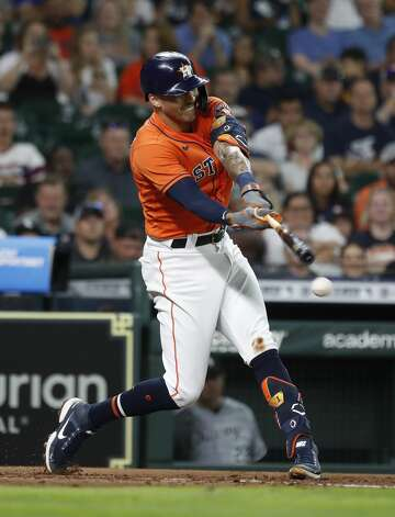 Houston Astros Carlos Correa (1) hits into a ground out during the second inning of an MLB baseball game at Minute Maid Park, Friday, June 18, 2021. Photo: Karen Warren/Staff Photographer / @2021 Houston Chronicle