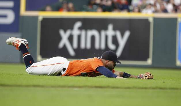 Houston Astros second baseman Jose Altuve (27) dives for Chicago White Sox Jake Lamb's single during the third inning of an MLB baseball game at Minute Maid Park, Friday, June 18, 2021. Photo: Karen Warren/Staff Photographer / @2021 Houston Chronicle